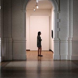 Girl looking at art on the wall