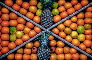Pineapples and oranges in four different triangles