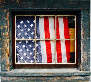 The American flag on the other side of a window