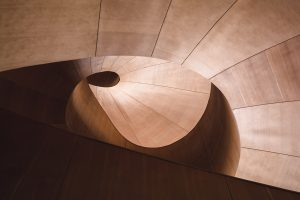 A photograph of a spiral structure made of wood.