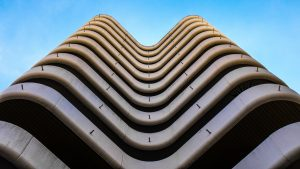 Photograph looking up a rounded building.
