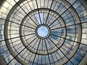 Photograph of a circular window in the ceiling of a building.
