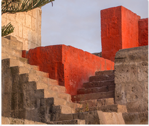 Stairs in Arequipa, Peru: Steps in ancient ruin. Two sets of old stone stairs intersect in an outdoor setting.